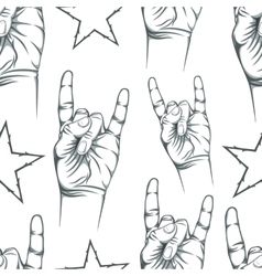 Seamless pattern with Rock n Roll sign and a stars vector image