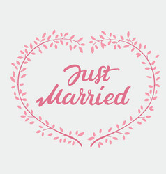 Lettering text just married and pink wreath vector