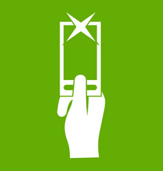 Hand photographs on smartphone icon green vector