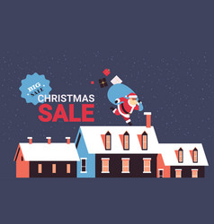 santa claus running with big sack on snowy houses vector image