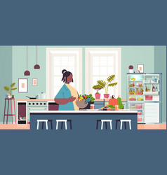 happy woman preparing healthy food at home cooking vector image