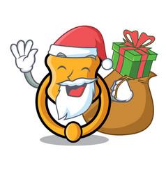 Santa with gift vintage door knocker on mascot vector