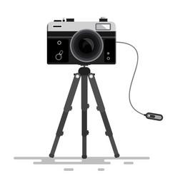 retro photo camera on tripod isolated on white vector image