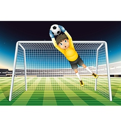 A boy catching the soccer ball vector