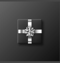 black gift box with metallic bow and ribbon vector image