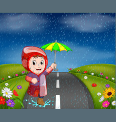 boys in raincoat running on road vector image