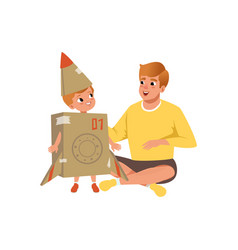 dad and his little son playing with cardboard vector image