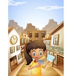 A girl watching the pictures while standing near vector