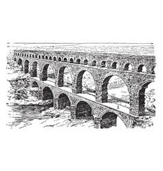 A roman aqueduct ancient nemausus vintage vector