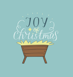 Hand lettering joy of christmas with manger vector