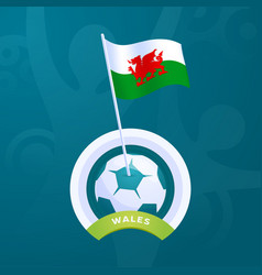 Wales flag pinned to a soccer ball european vector