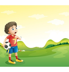 A tired young soccer player in his red uniform vector image
