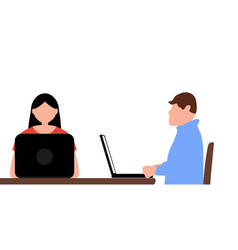 man and a woman work in an office behind laptops vector image