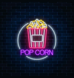 Neon glowing sign of pop corn in circle frame on vector