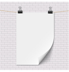 Blank white paper poster hanging on brick white vector