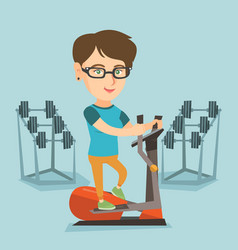 caucasian woman exercising on elliptical trainer vector image