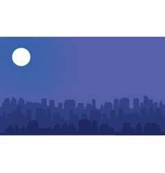 Silhouette of big city with moon vector