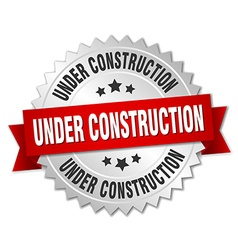 Under construction 3d silver badge with red ribbon vector