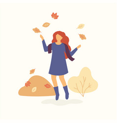 girl is jumping and throwing autumn leaves up and vector image