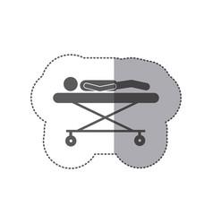 sticker monochrome pictogram patient in stretcher vector image