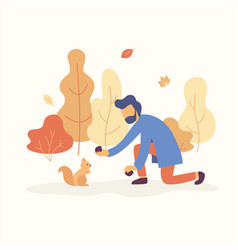 man feeding a squirrel in the park with fall mood vector image