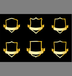 set of golden shields with ribbon vector image