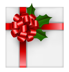 Christmas gift with red bow and holly vector image