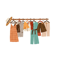 Stylish fashion clothes hanging on hangers vector