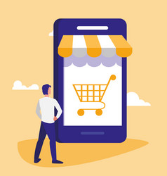 Young man using smartphone with shopping cart vector