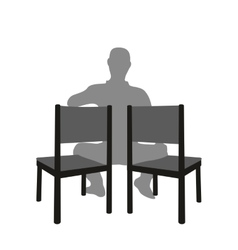 Silhouette of a man sitting in a two chair vector image vector image