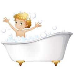 A young boy taking a bath at the bathtub vector image vector image