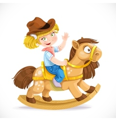 Cute little girl sits on the toy rocking horse vector image