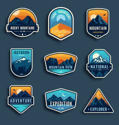 set of nine mountain travel emblems camping vector image