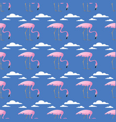 Seamless pattern with pink flamingos and clouds vector