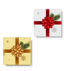 realistic gift box with gold and red bow vector image