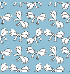 Seamless pattern with bows isolated on blue vector