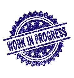 Grunge textured work in progress stamp seal vector