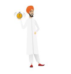 Hindu businessman holding alarm clock vector