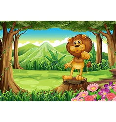 A king lion above the stump at the forest vector