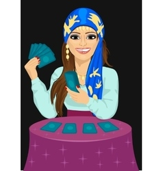 Young fortune teller with tarot cards vector image