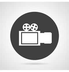 Movie camera black round icon vector image
