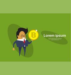 Asian business man holding bitcoin web money vector