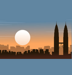 Silhouette of malaysia city landscape at sunrise vector