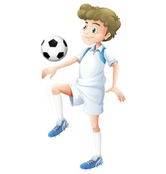 A tall boy playing soccer vector image vector image