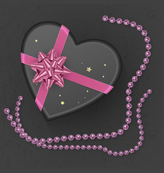 A realistic black gift box with shape of heart vector
