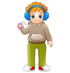 Cartoon boy listening music player vector