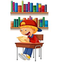 A boy reading on table vector