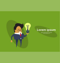 Business man holding light bulb asian cartoon vector