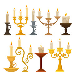 collection of candles in candlesticks vintage vector image