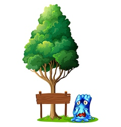 An empty signboard under the tree beside the vector image vector image
